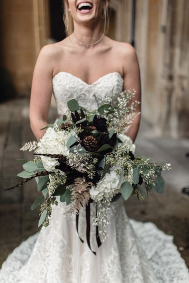 Winter Wedding Bouquet // Bride In Alice Dress By Watters // Christmas Pub Wedding At The Falcon Rotherwick With Bride In Alice By Watters And Candle Lit Wedding Ceremony Images By Rebecca Searle Photography