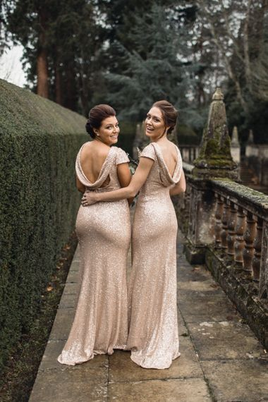 Bridesmaids In Pale Gold Sequinned Dresses // Christmas Pub Wedding At The Falcon Rotherwick With Bride In Alice By Watters And Candle Lit Wedding Ceremony Images By Rebecca Searle Photography