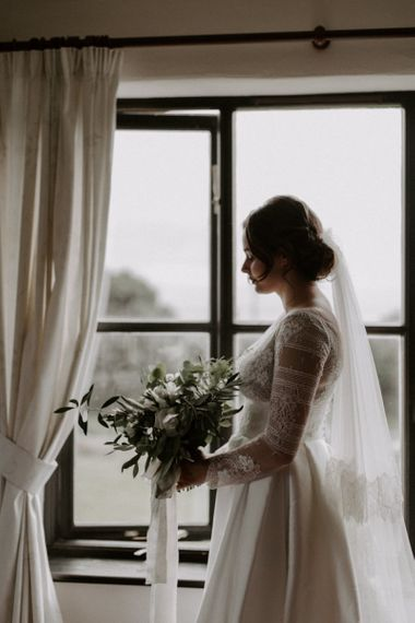 Bride During Wedding Preparations with Bouquet