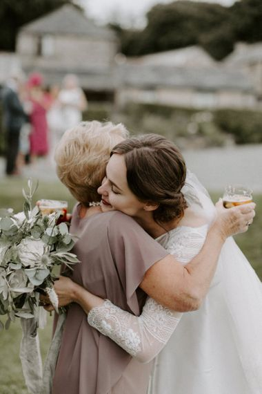 Bride Greeting Guest Holding Flower Bouquet