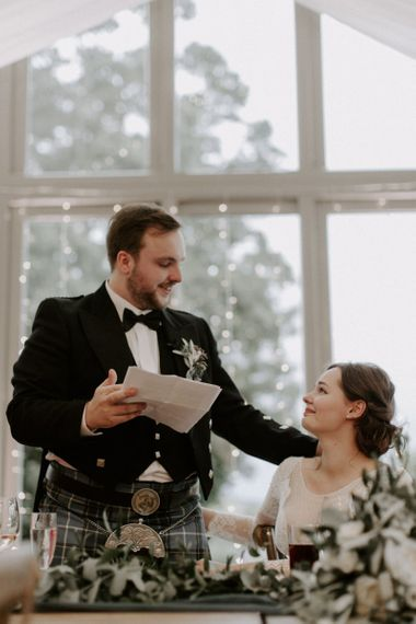 Bride Gazes at Groom During Speech