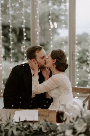 Bride and Groom Kiss After Speech