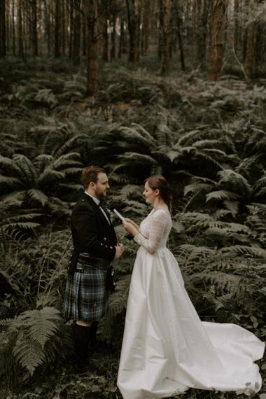 Bride and Groom Exchange Personal Vows In Woods