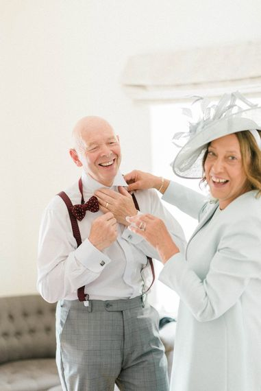 Mother of the Bride in Pale Blue Jacket and Hat | Father of the Bride in Grey Suit with Burgundy Braces, Bow Tie and Brogues | Country Tipi Wedding with Macramé Arch and Hanging Flowers | Sarah-Jane Ethan Photography