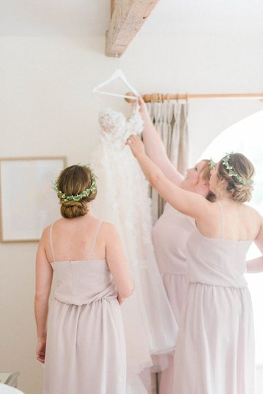 Strapless Liz Martinez Ballgown Wedding Dress with Embroidered Flowers | Bridesmaids in Blush Pink Rita Roushdy Dresses | Flower Crowns | Country Tipi Wedding with Macramé Arch and Hanging Flowers | Sarah-Jane Ethan Photography