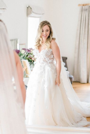 Bride in Strapless Liz Martinez Ballgown Wedding Dress with Embroidered Flowers | Cathedral Length Veil in Blush Soft Tulle | Half Up Half Down Bridal Hair Style | Country Tipi Wedding with Macramé Arch and Hanging Flowers | Sarah-Jane Ethan Photography
