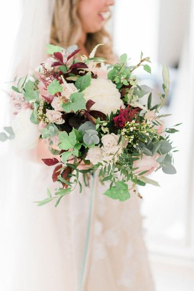 Oversized Bridal Bouquet of White Peonies, Blush Astlibe, Trailing Greenery and Burgundy Eucalyptus | Country Tipi Wedding with Macramé Arch and Hanging Flowers | Sarah-Jane Ethan Photography