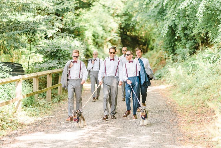 Miniature Schnauzer Ring Bearers | Groom in Navy Blue Suit with Burgundy Braces, Bow Tie and Brogues | Groomsmen in Grey Suits with Burgundy Braces, Bow Ties and Brogues | Country Tipi Wedding with Macramé Arch and Hanging Flowers | Sarah-Jane Ethan Photography