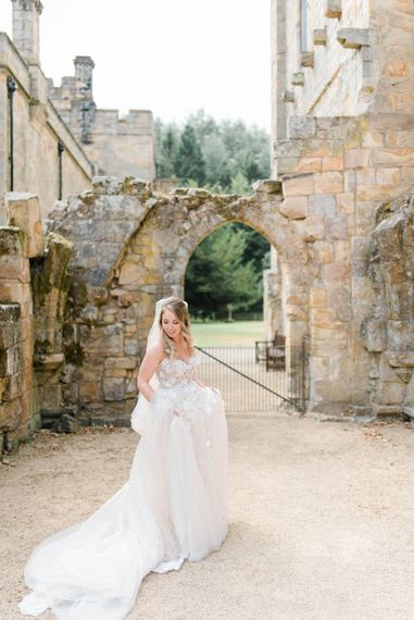 Bride in Strapless Liz Martinez Ballgown Wedding Dress with Embroidered Flowers | Cathedral Length Veil in Blush Soft Tulle | Country Tipi Wedding with Macramé Arch and Hanging Flowers | Sarah-Jane Ethan Photography