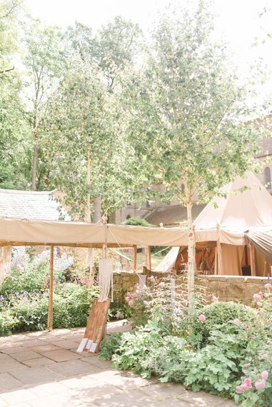 Tipi at Brinkburn Priory | Country Tipi Wedding with Macramé Arch and Hanging Flowers | Sarah-Jane Ethan Photography