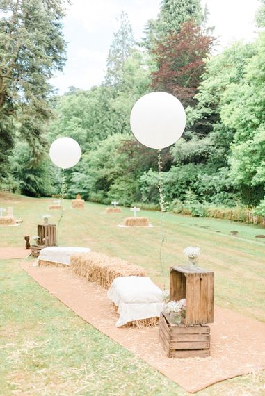 Garden Party Games | Hay Bales | Giant White Balloons | Country Tipi Wedding with Macramé Arch and Hanging Flowers | Sarah-Jane Ethan Photography