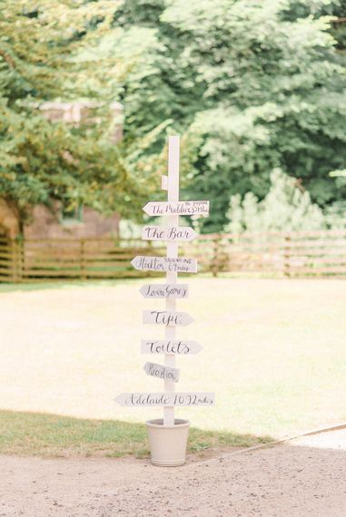 Wedding Signpost | Country Tipi Wedding with Macramé Arch and Hanging Flowers | Sarah-Jane Ethan Photography