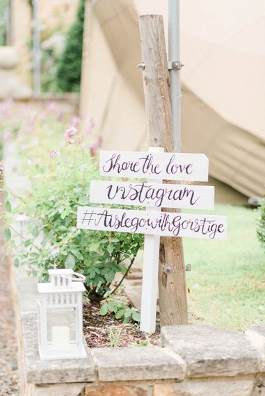 Wedding Hashtag Sign | Country Tipi Wedding with Macramé Arch and Hanging Flowers | Sarah-Jane Ethan Photography