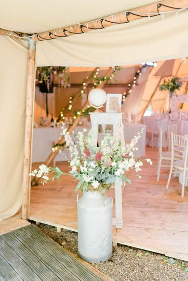 Tipi Decor | Large Urn Filled with Flowers | Country Tipi Wedding with Macramé Arch and Hanging Flowers | Sarah-Jane Ethan Photography
