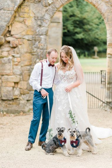 Miniature Schnauzer Ring Bearers in Burgundy Bow Ties | Bride in Strapless Liz Martinez Ballgown Wedding Dress with Embroidered Flowers | Groom in Navy Blue Suit with Burgundy Braces, Bow Tie and Brogues | Country Tipi Wedding with Macramé Arch and Hanging Flowers | Sarah-Jane Ethan Photography