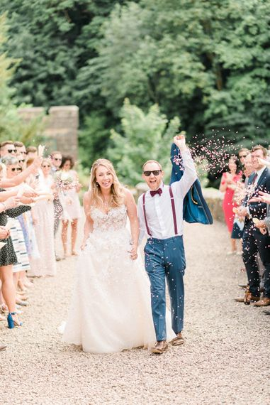 Confetti Toss | Bride in Strapless Liz Martinez Ballgown Wedding Dress with Embroidered Flowers | Groom in Navy Blue Suit with Burgundy Braces, Bow Tie and Brogues | Country Tipi Wedding with Macramé Arch and Hanging Flowers | Sarah-Jane Ethan Photography