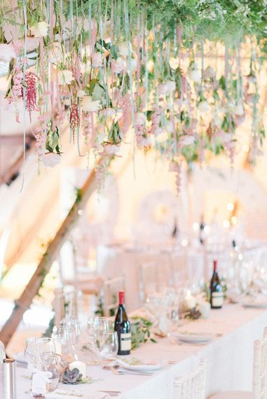 Top Table | Hanging Floral Installation with Trailing Ribbons and Glass Orbs | Country Tipi Wedding with Macramé Arch and Hanging Flowers | Sarah-Jane Ethan Photography