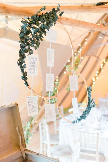 Wedding Reception Decor | Copper Hoops and Eucalytpus Table Plan | Country Tipi Wedding with Macramé Arch and Hanging Flowers | Sarah-Jane Ethan Photography