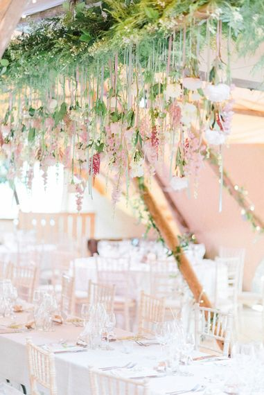 Wedding Reception Decor | Hanging Floral Installation with Trailing Ribbons and Glass Orbs | Top Table | Country Tipi Wedding with Macramé Arch and Hanging Flowers | Sarah-Jane Ethan Photography