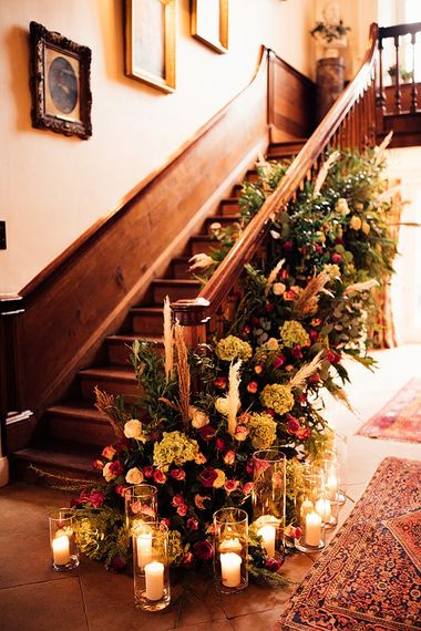 Wedding flowers staircase decor at Iscoyd Park