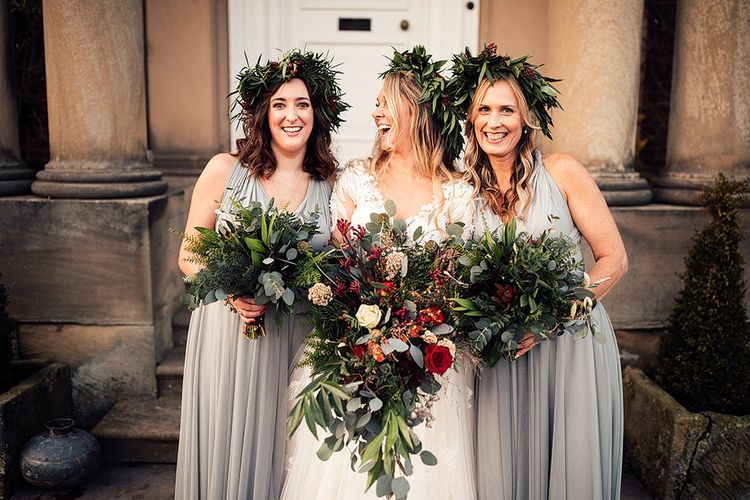Bride in Riki Dalal wedding dress with bridesmaids all wearing foliage crowns