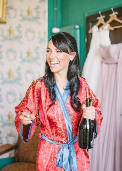 Beautiful Bride Popping Champagne on Wedding Morning