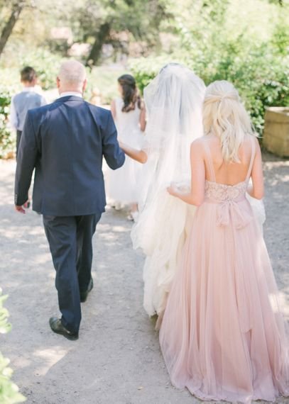 Bridal Party Walking To The Outdoor Wedding Ceremony