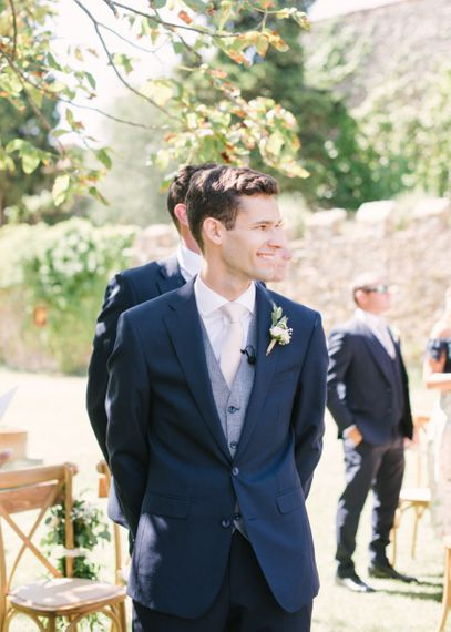 Groom at the Altar in Navy Suit with Wool Waistcoat and Pink Tie