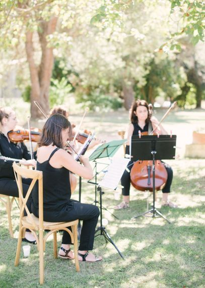 String Quartet Playing During The Wedding Ceremony