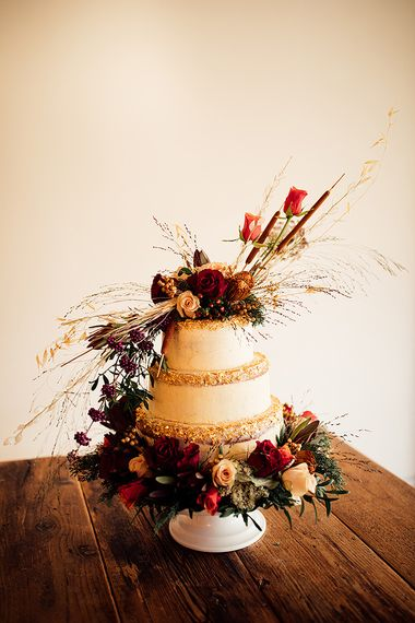 Wedding cake with red flower decor