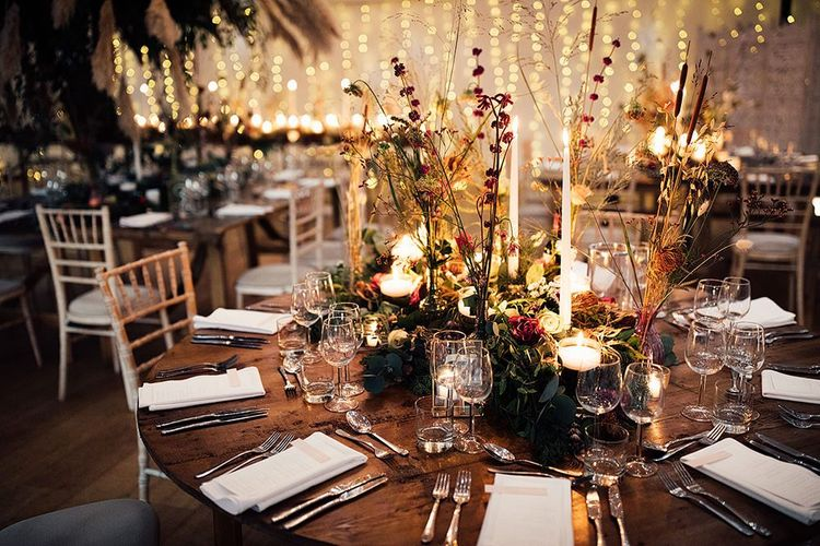 Winter wedding table decor with florals and gold details
