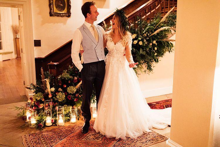 Cosy wedding decor for groom with bride in Riki Dalal wedding dress