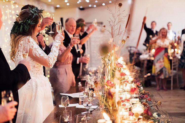 Bride in Riki Dalal wedding dress during wedding toast