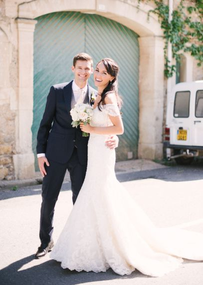Bride and Groom Portrait with Bride in Lace David Tutera Wedding Dress and Groom in Navy Three Piece Suit