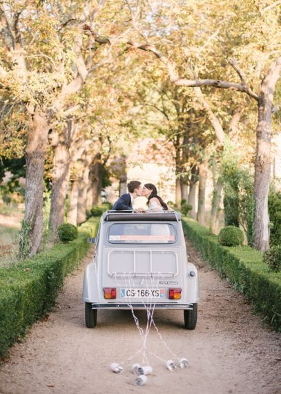 Bride and Groom Riding off in a Convertible 2CV car