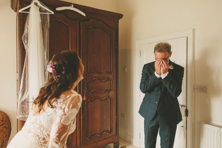 Father sees bride for first time in wedding dress