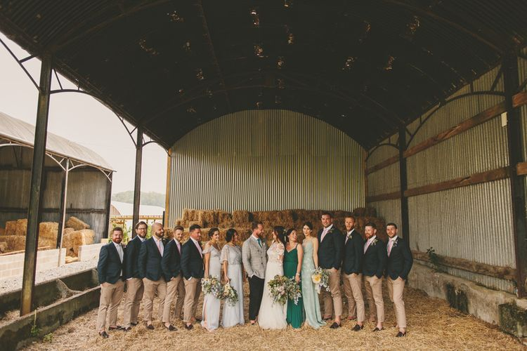 Wedding party in barn wedding venue