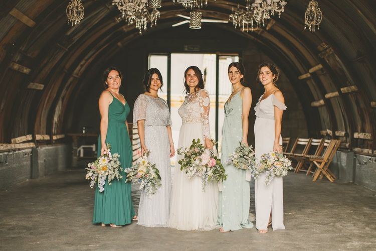 Mismatched green bridesmaid dresses