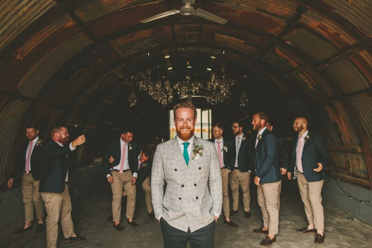 Groom with groomsmen in matching outfits