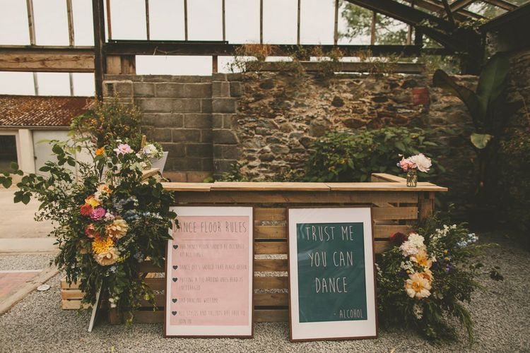Homemade bar with wedding signs