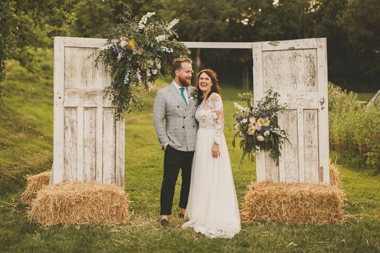 Homemade door arch at rustic wedding with macrame table runner