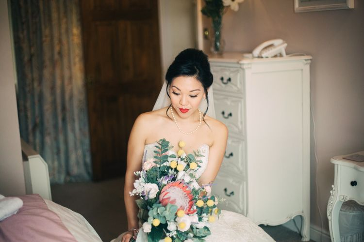 Bride on Wedding Morning Holding Protea Wedding Bouquet