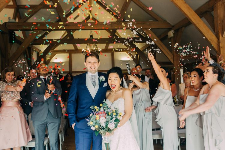 Bride and Groom Just Married Moment with Colourful Confetti Bomb