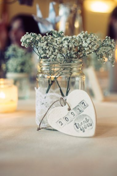 Glass Jar Wrapped in Lace and Filled with Gypsophila and  Handmade Salt Dough Heart Wedding Favours