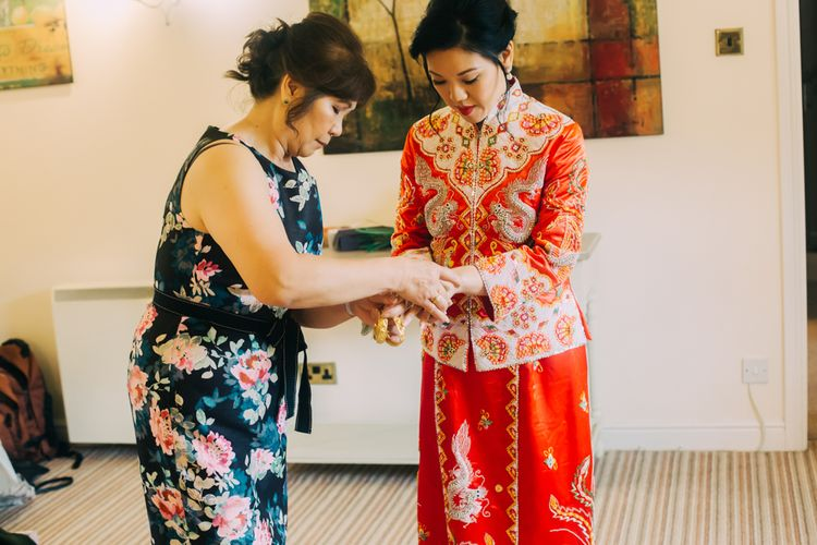 Bride Getting Ready in Red Chinese Wedding Dress