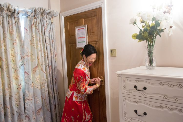 Bride in Red Chinese Wedding Dress Answering Door to Husband-to-be