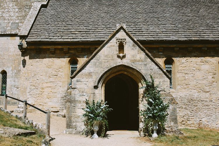 Church Wedding Ceremony Entrance Decorated with Floral Arrangements