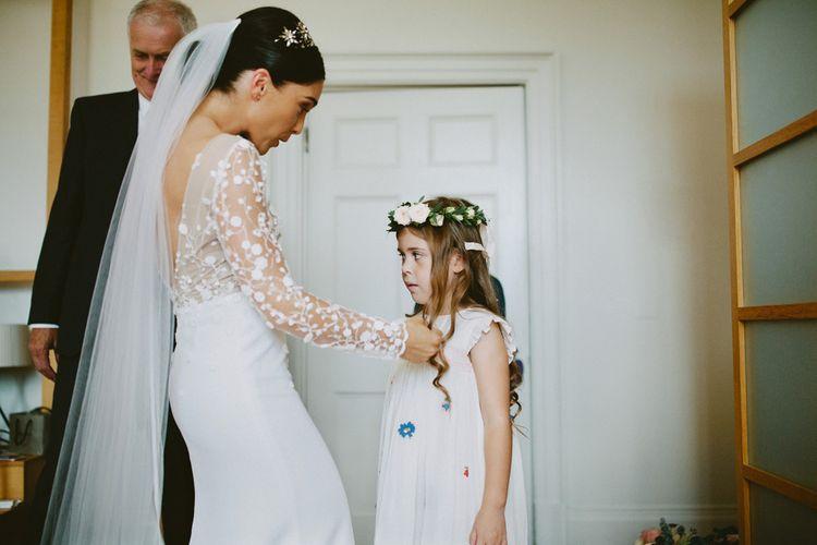 Bride in Applique Rime Arodaky Long Sleeve Wedding Dress and Flower Girl on Wedding Morning