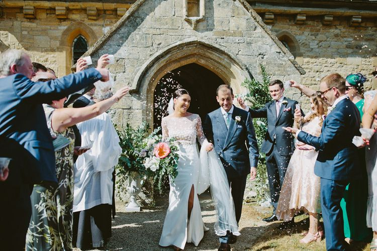 Church Confetti Exit with Bride in Applique Rime Arodaky Long Sleeve Wedding Dress and Groom in Checked Suit