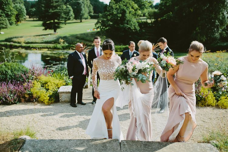 Bride in Rime Arodaky  Applique Long Sleeve Wedding Dress with Front Split and Bridesmaids in Pink Dresses